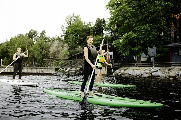 Women surfing in river water